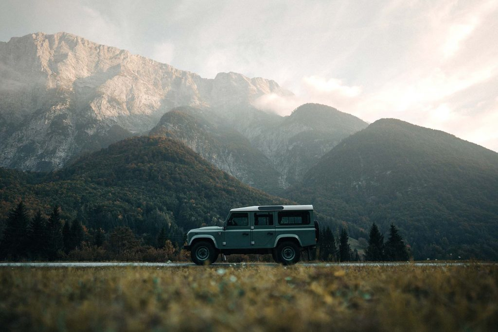 Automotive Photo of Landrover Defender 110 in front of the slovenian alps, photo by Brian Rauschert